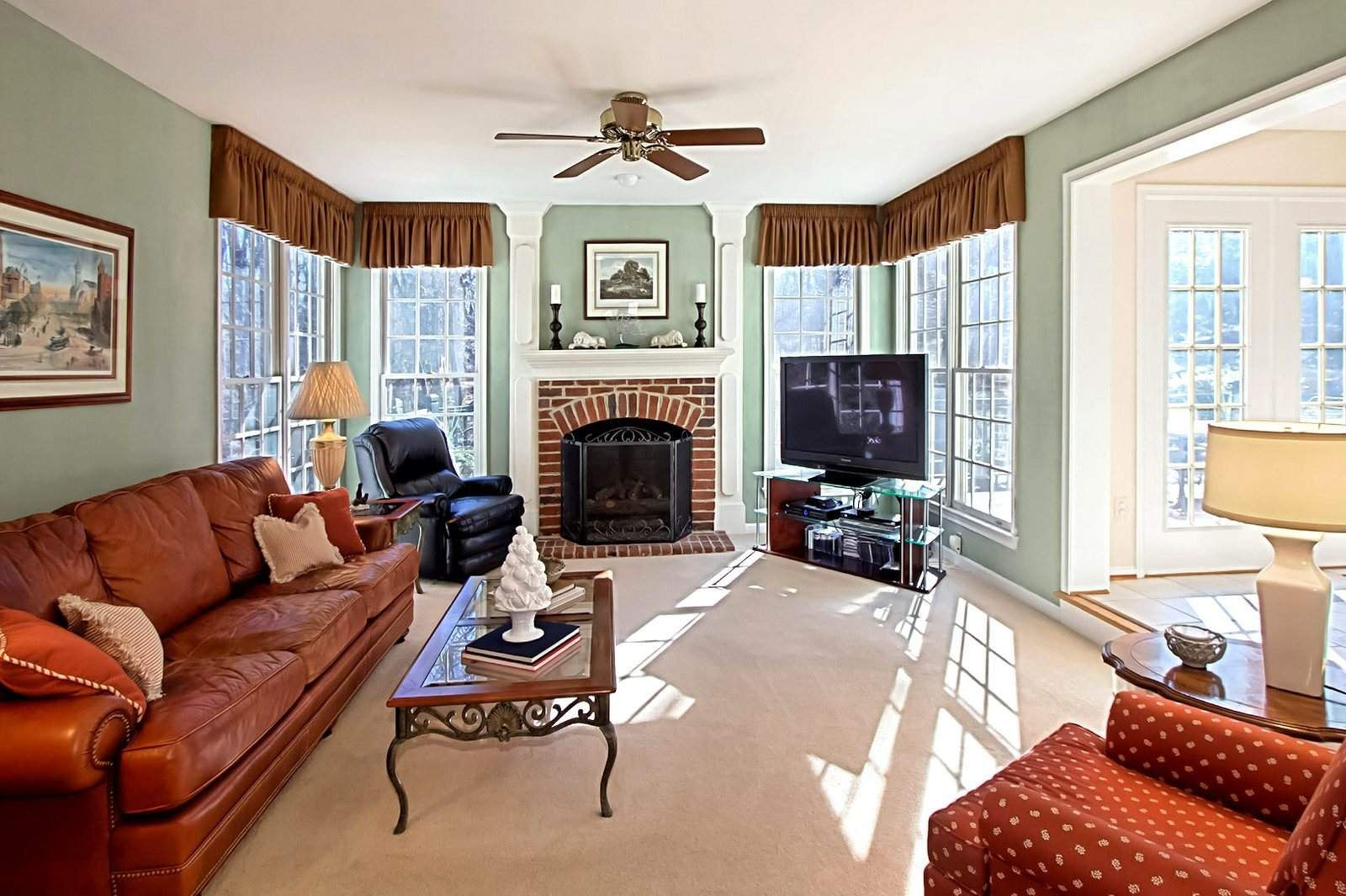 Rooms with red brick fireplaces open foyer impresses in for Family in the living room