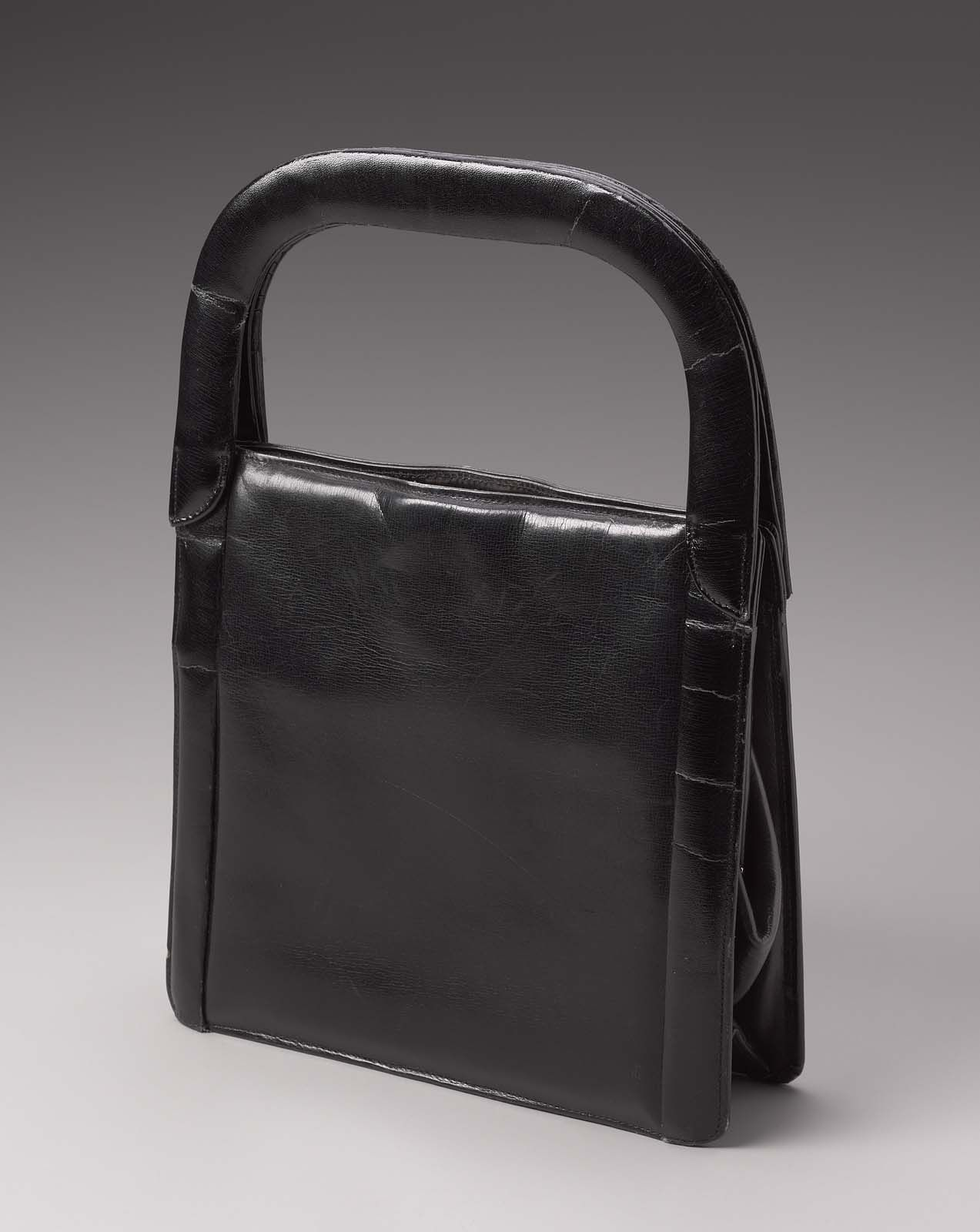 f7c013fe3da8 Black leather rectangular handbag with beige suede lining and leather  handle