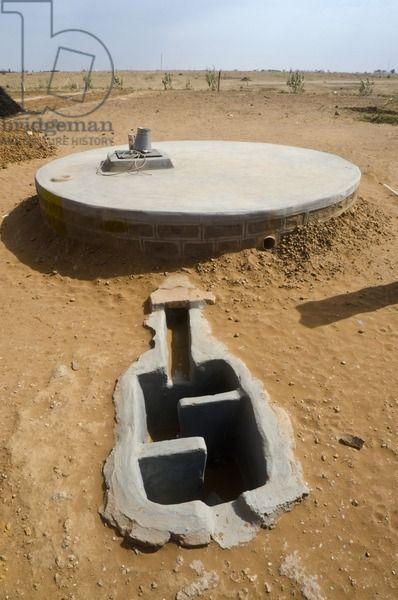 Underground drinking water storage tank in desert landscape