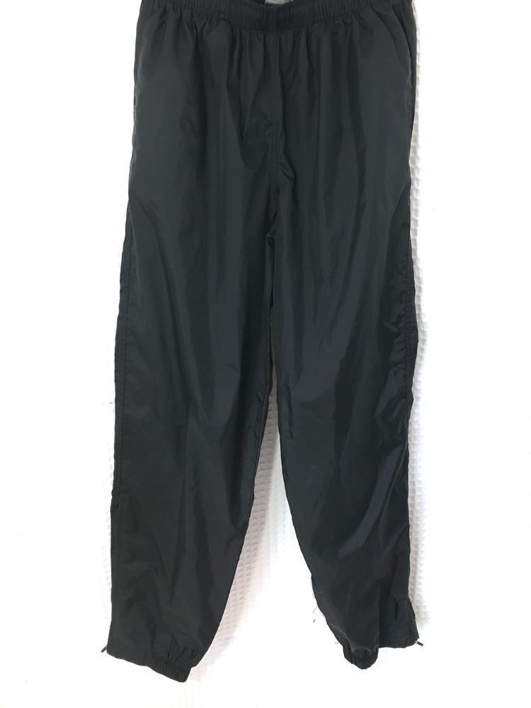 NIKE Women s Sz Large Wind Pants Unlined 100% Nylon Zip Elastic Ankles  Black  72f4907e35