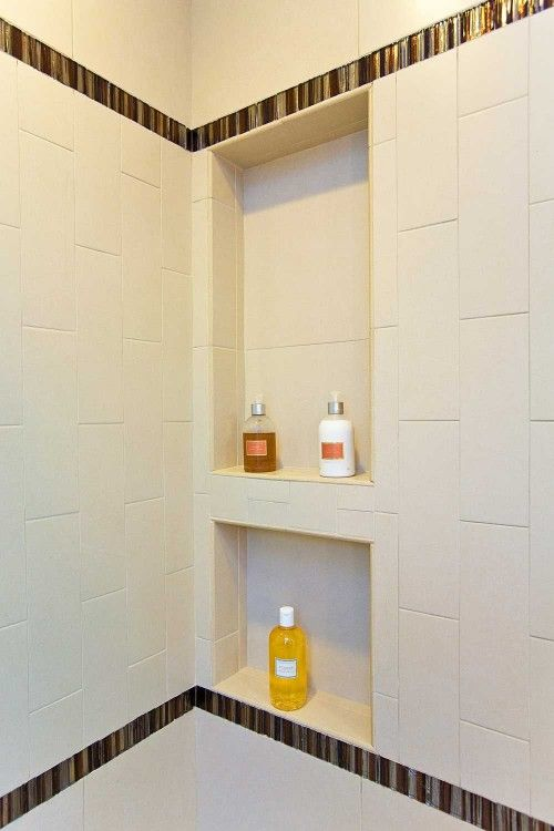 A place for shampoo and soap. A small, recess in the