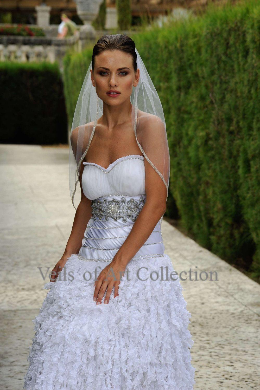 Designer one tier embroided bridal wedding veil fingertip style