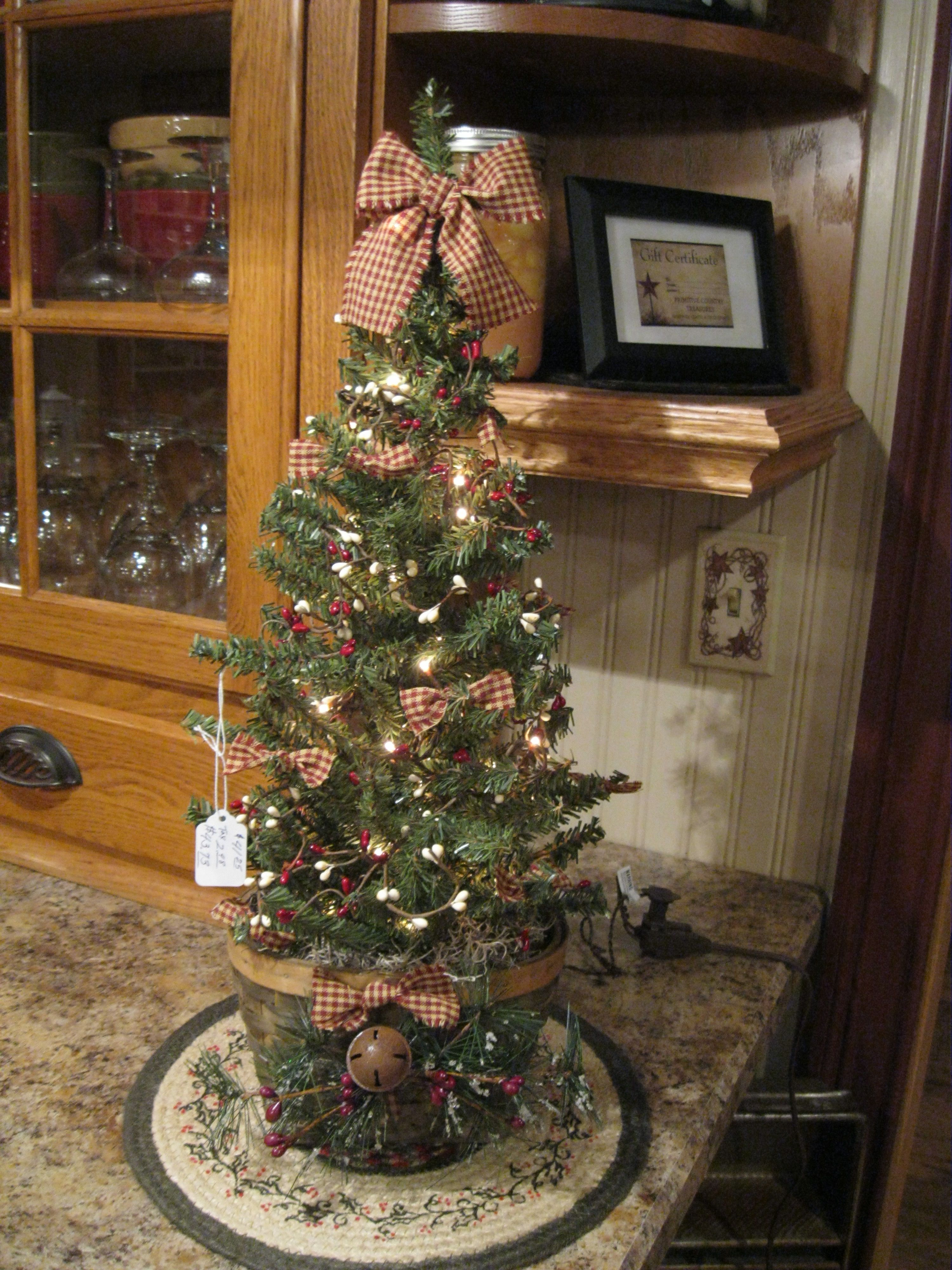 Country Christmas Tree...cute idea for a hutch or on a ...