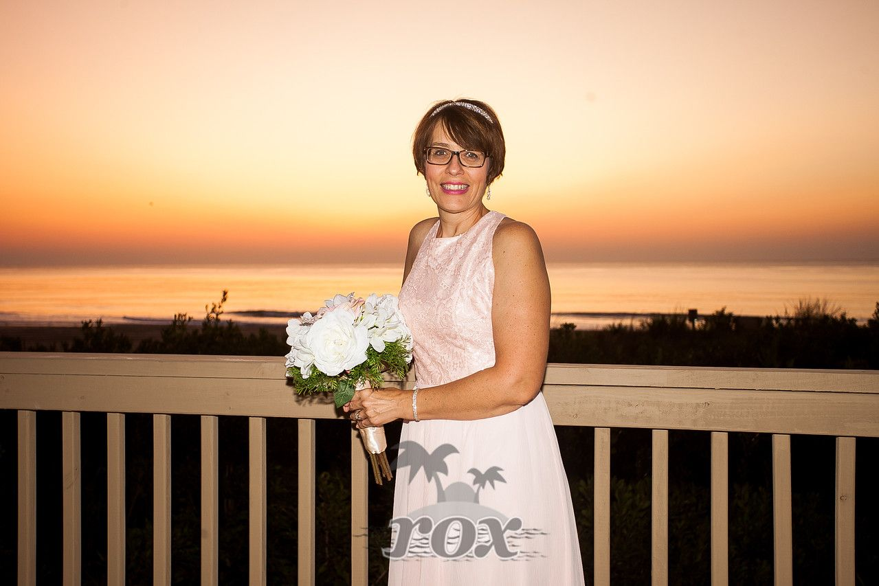 Sunrise beach wedding  Beach bride at sunrise before wedding in front of the Century One in