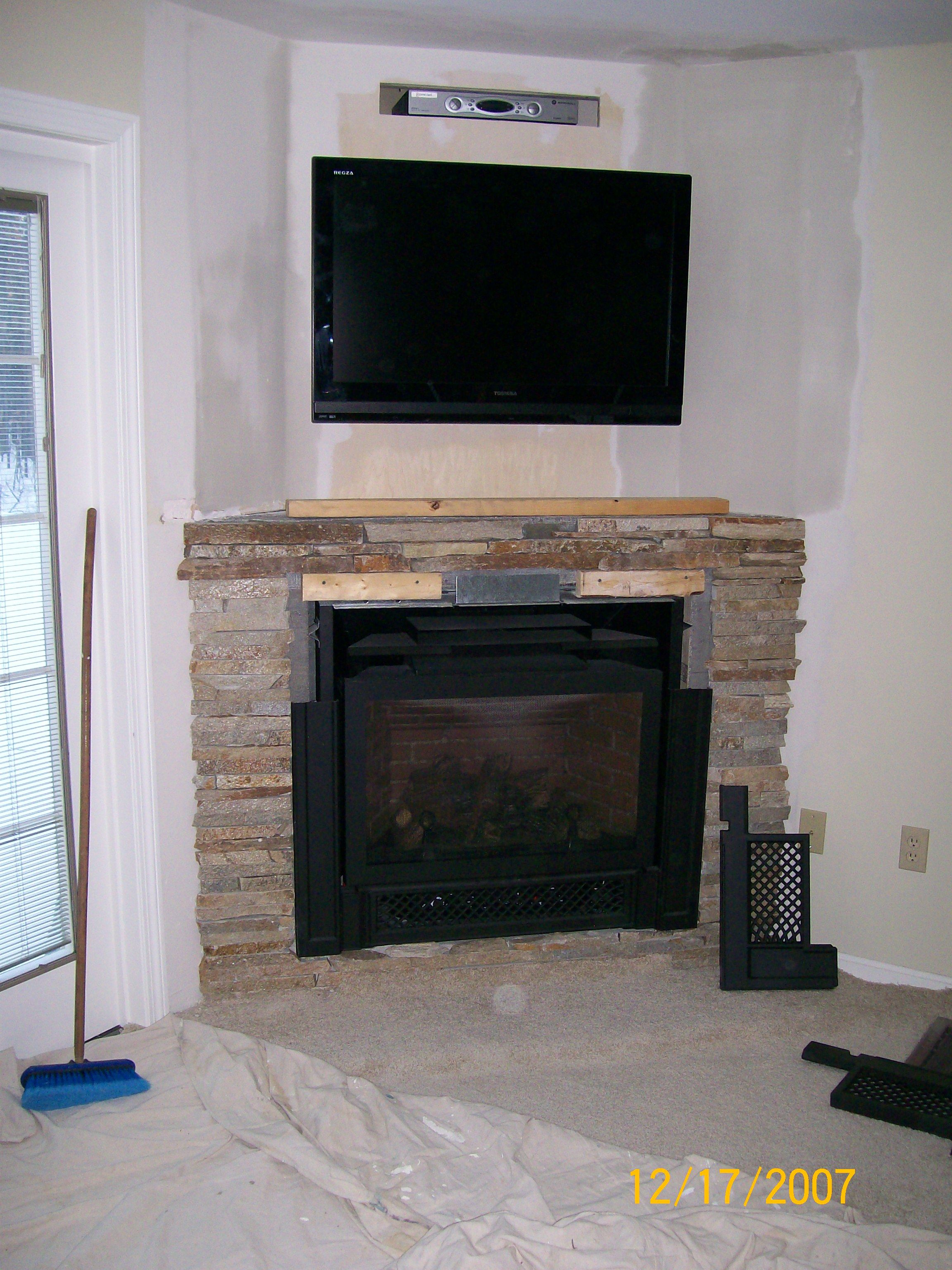corner fireplaces and finally a gas fireplace in an unused corner with a flat screen