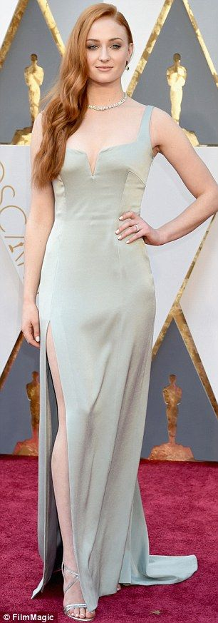 Head Turner: Sophie was drawing plenty of stares after wearing this pleasingly figure-hugging gown
