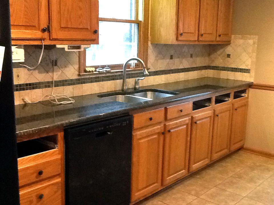 Best Coffee Brown Granite On Medium Wood Cabinets Kitchen 400 x 300