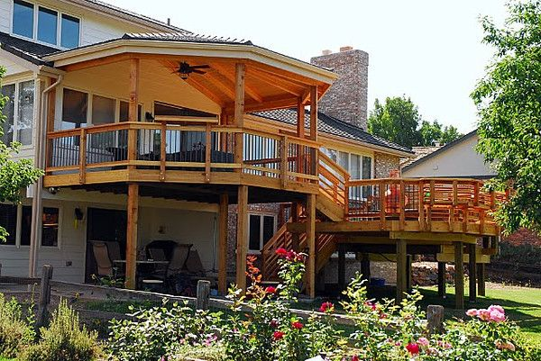 Multi level redwood deck with covered dining area designed for Multi level deck design
