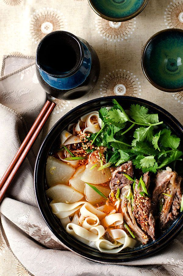 Lanzhou Beef Noodles - The springy noodles are served with a rich beef broth, melt-in-your-mouth beef, tender radish and a splash of freshly made chili oil | omnivorescookbook.com
