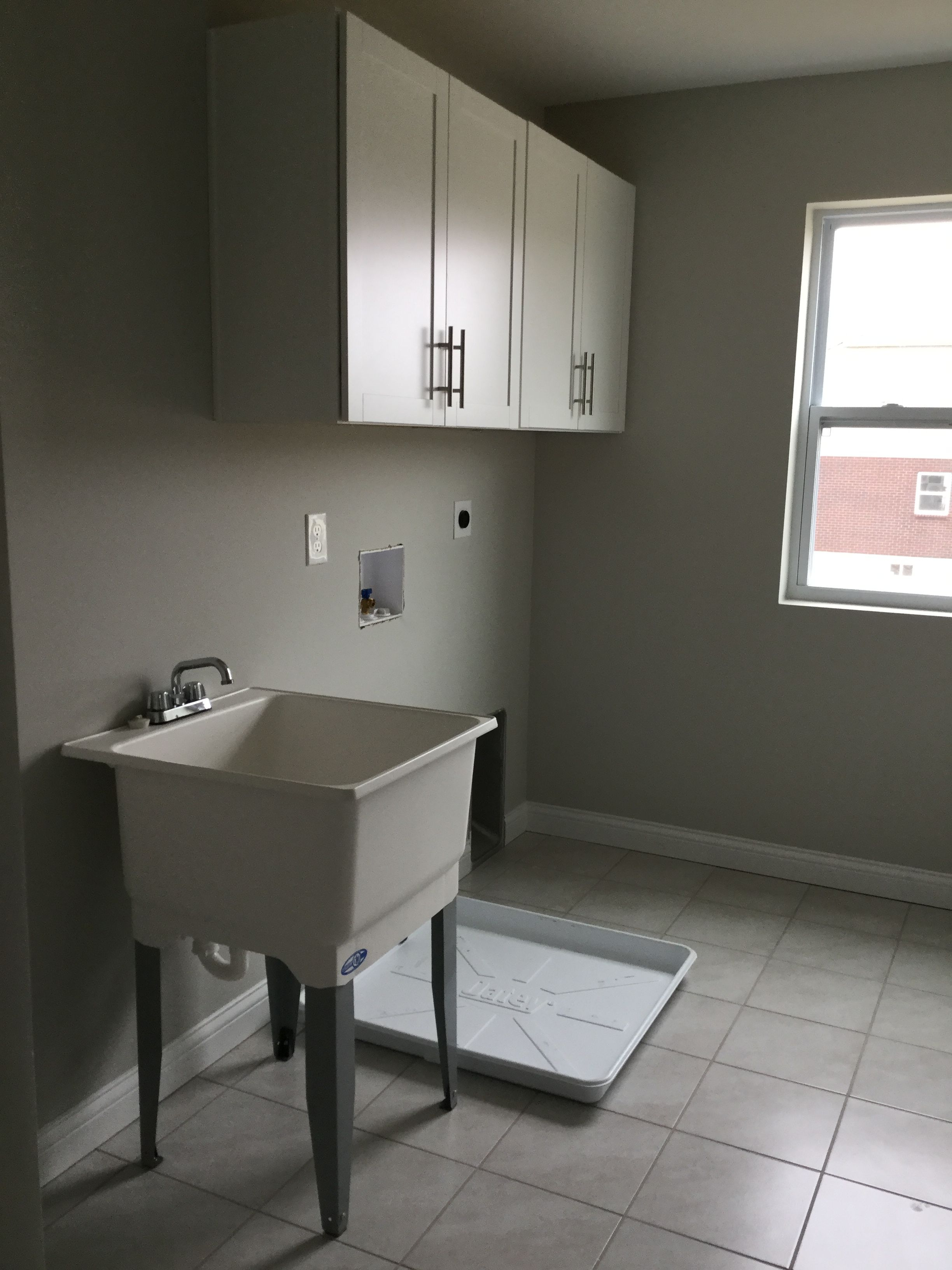 Best Brellin White Cabinets With Laundry Tub In Laundry Room 400 x 300