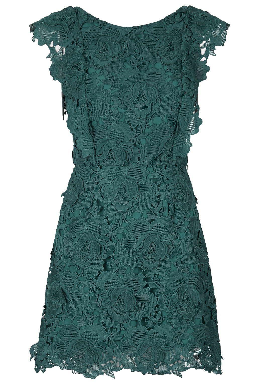 Kimberley Garner puts on a leggy display in green lace dress ...