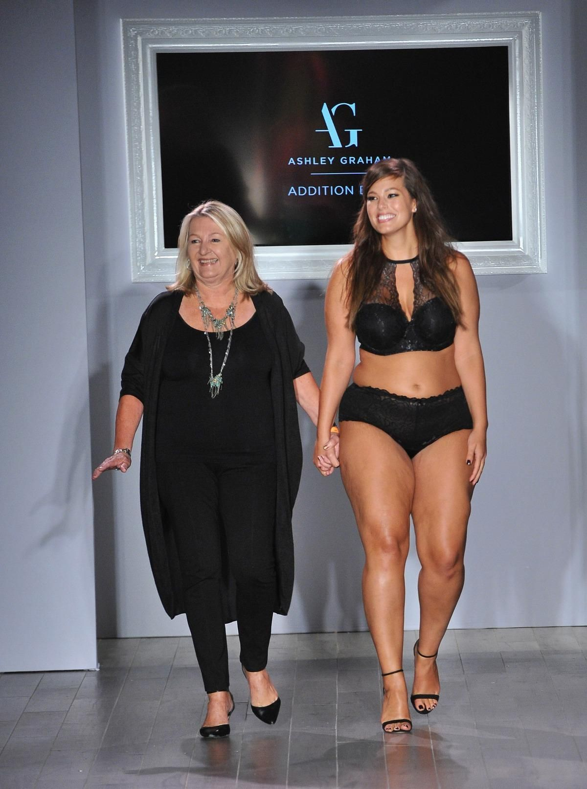 Model and plus-size fashion advocate Ashley Graham strutted down the Fashion  Week runway on Tuesday, modeling her lingerie collaboration with  body-diverse ...