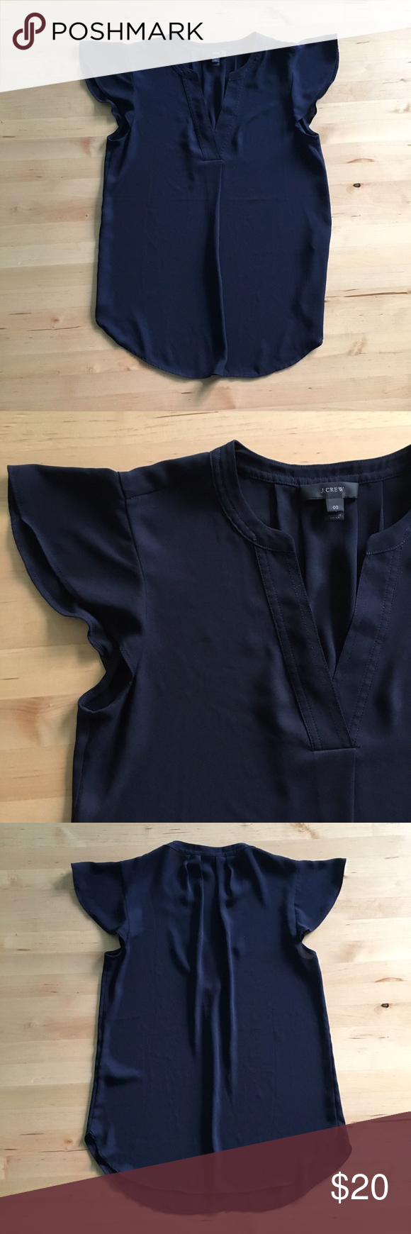 J. Crew Flutter Sleeve Top Navy flutter sleeve blouse, perfect business attire. Made of silky polyester that feels great on the skin and doesn't wrinkle easily. Great condition. J. Crew Tops Blouses