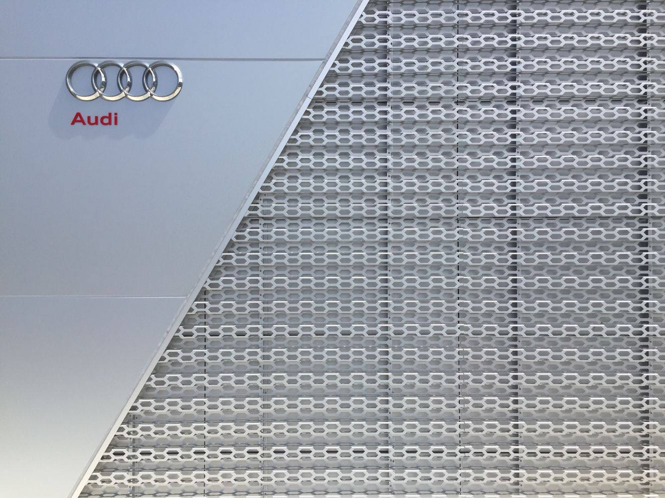 Facade Detail   The Outer Skin Consists Of Bent Aluminium Panels Perforated  With Honeycomb Shaped Holes