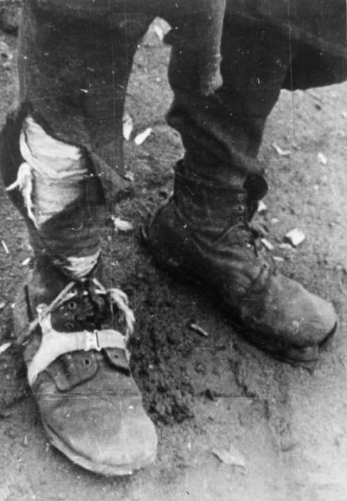Improvised boots of a Polish deportee, recently released from a Soviet Gulag awaiting to enlist in the Polish Army in the Soviet Union after Barbarossa/Buzuluk, Russia