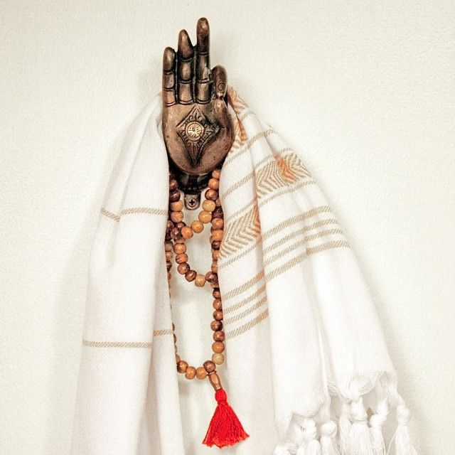 photo by apartmentf15 - bathroom detail - buddha hand, fouta hammam towel, mala prayer beads