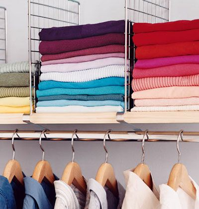 Use Shelf Dividers To Separate Stacks Of Shirts And Sweaters