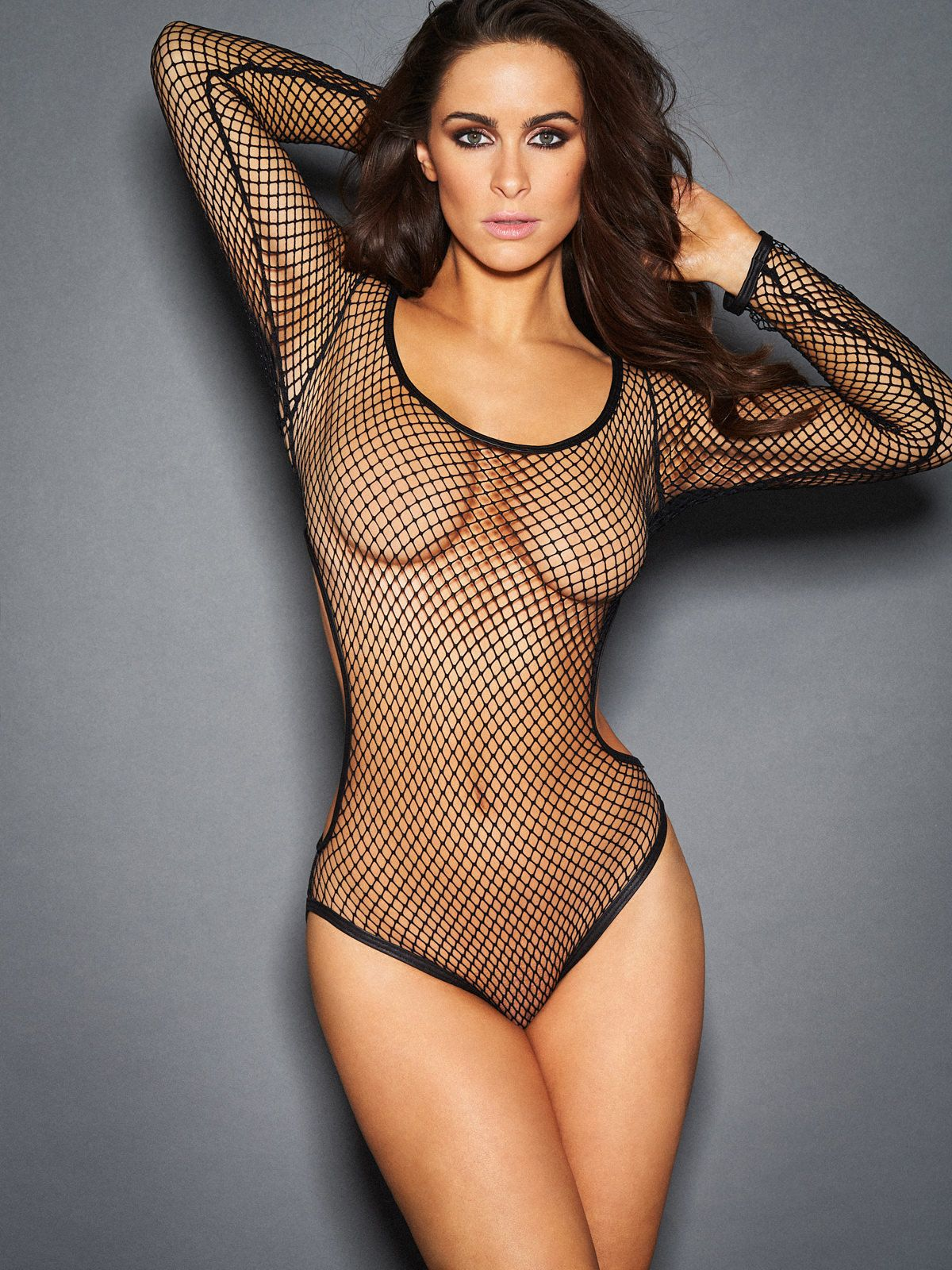 6298e0b8bb3 Allover fishnet long sleeve bodysuit with cut out sides. Vegan leather  piping along neck