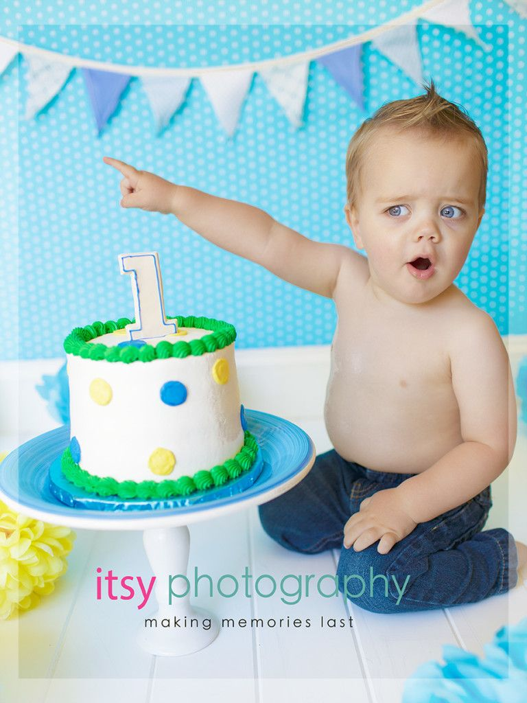 little boy with blue green and yellow cake for 1st birthday Cake