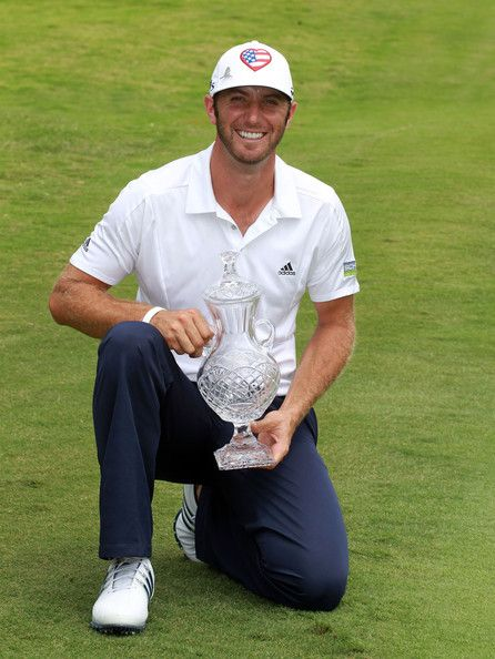 Dustin Johnson Dustin Johnson holds the winner's trophy after winning the FedEx St. Jude Classic at TPC Southwind on June 10, 2012 in Memphis, Tennessee.
