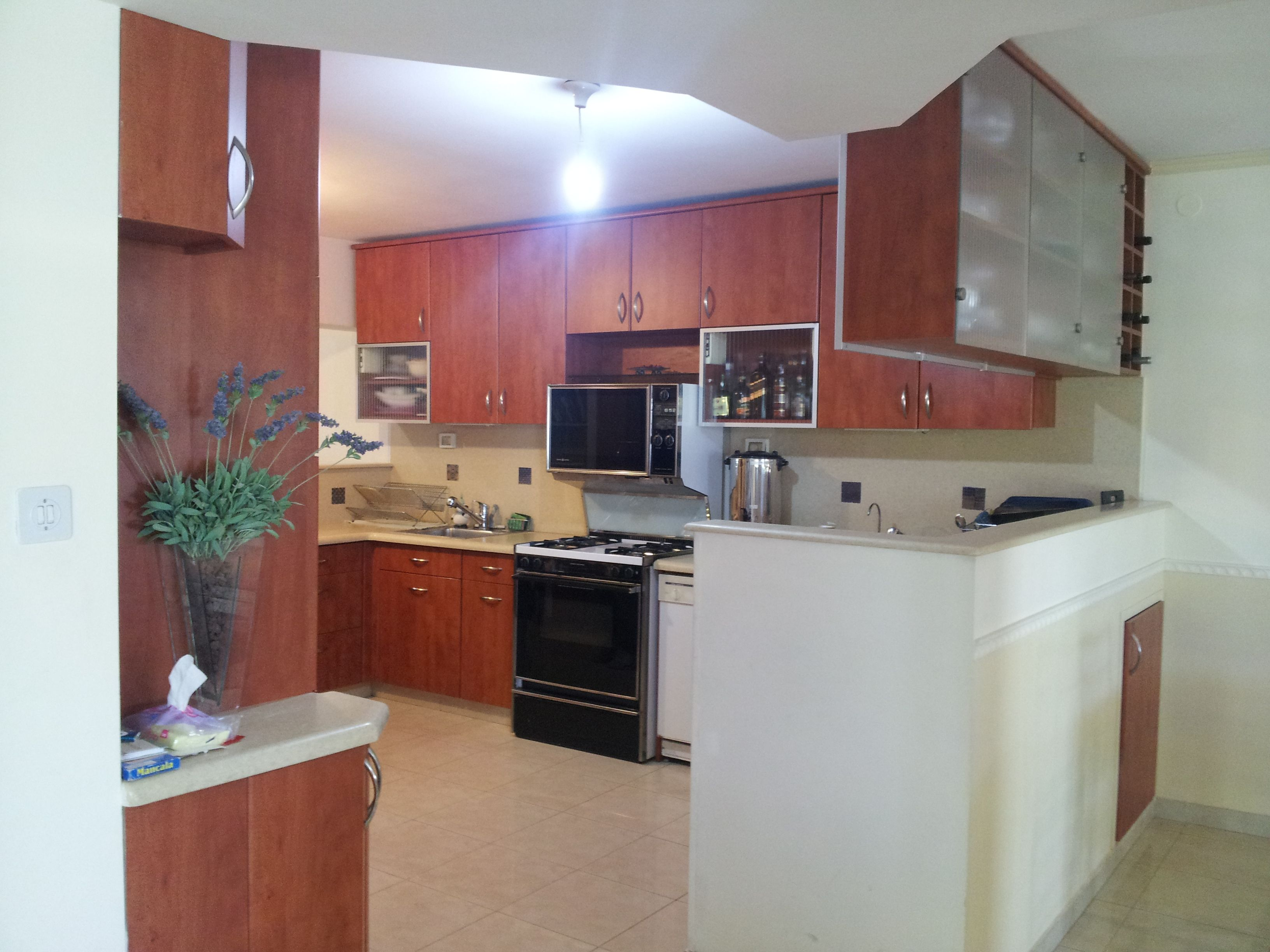 Counter & ceiling cabinets create a wall between kitchen ...