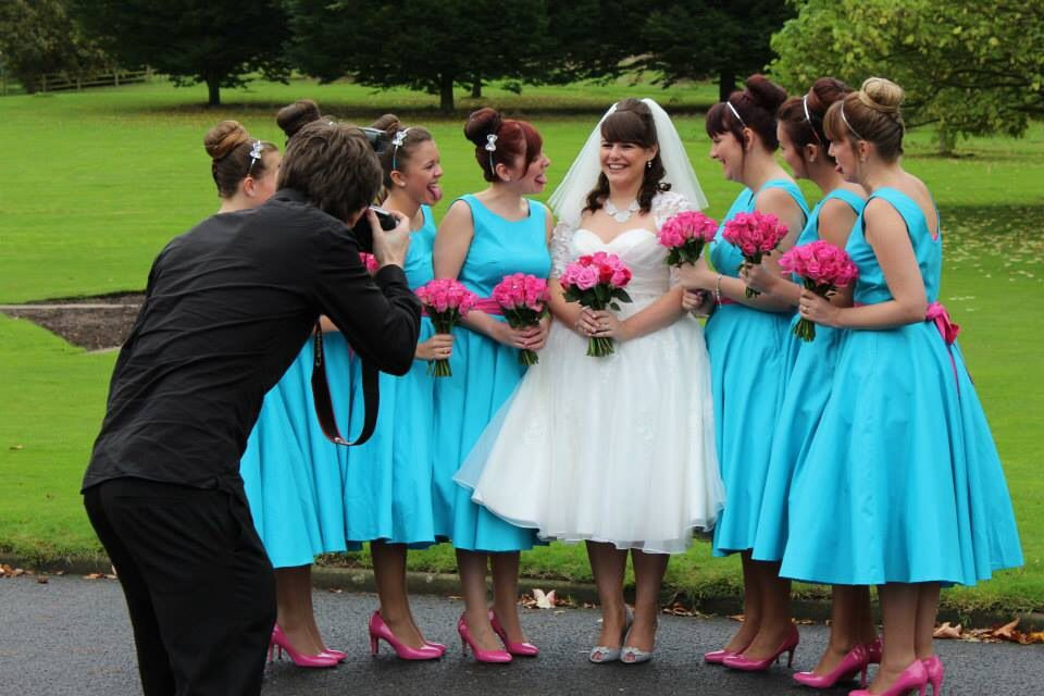 Bridesmaids and the Bride. Silly face. Wedding pictures.