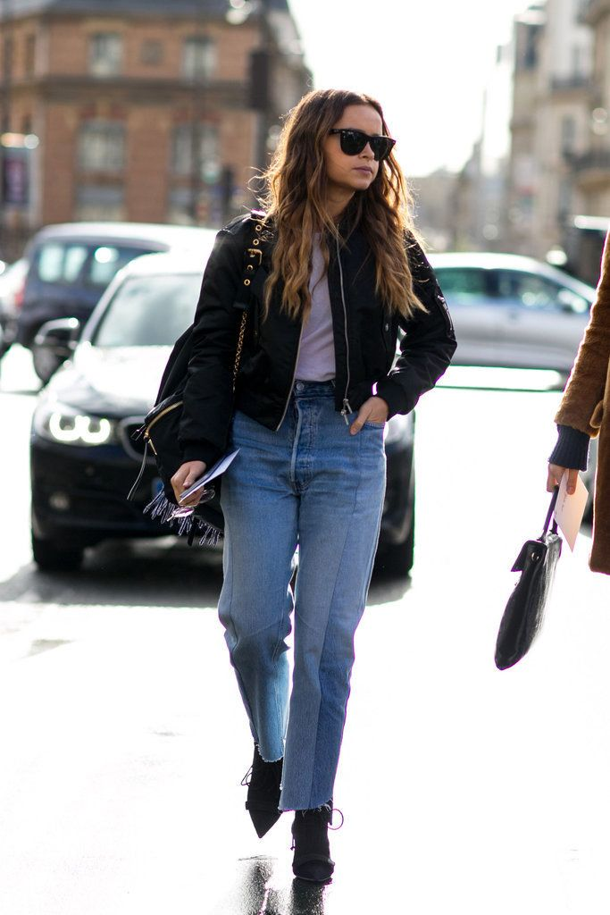 Patchwork jeans, a bomber jacket, and ankle boots.