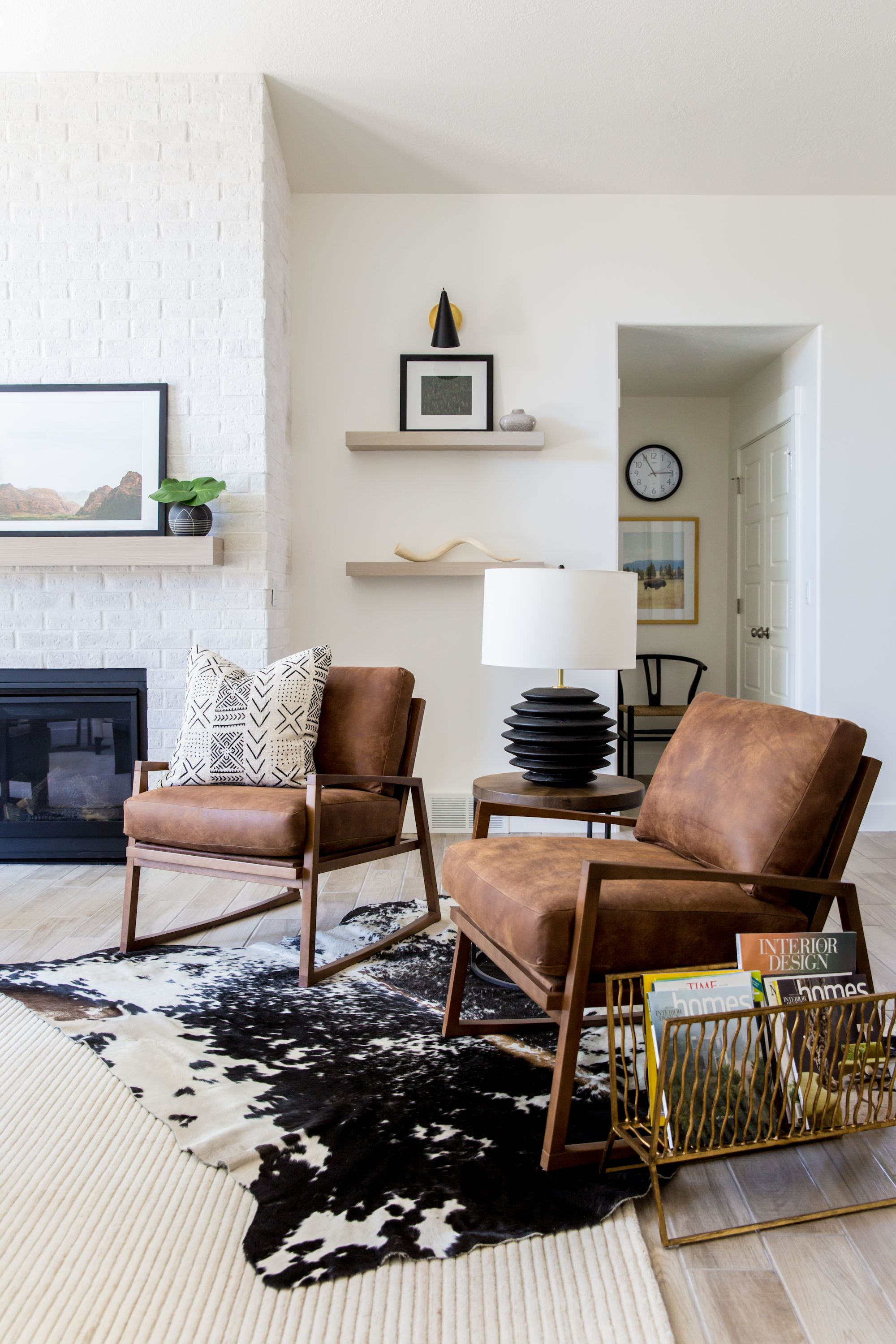 Crisp White Walls Layered Rugs And The Unmistakable Form Of
