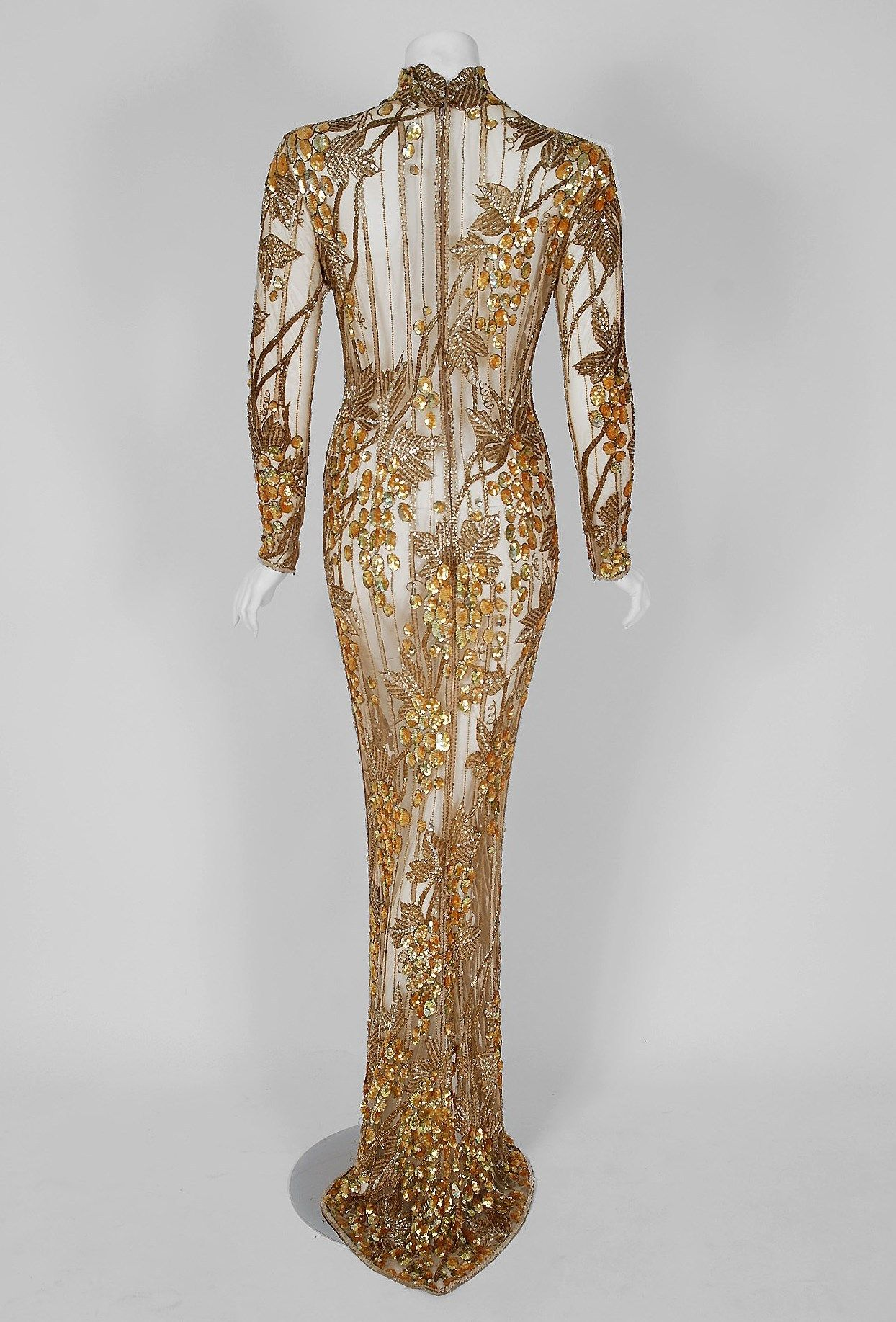 98840b94 1995 Iconic Sharon Stone Casino Gold Sequin Beaded Illusion Gown By Bob  Mackie Fashioned in a seductive nude embroidered net, the beaded and sequin  ...