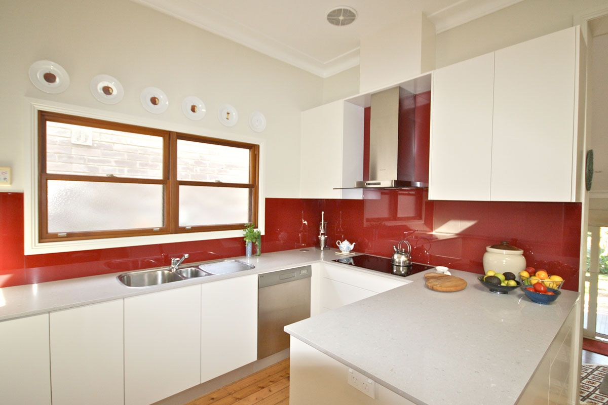 4130 clamshell very pale grey countertops with vibrant splashback 2 4130 clamshell kitchens by emanuel caesarstone benchtops