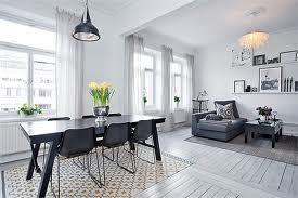 salones estilo nórdico - Mesa y sillas en negro