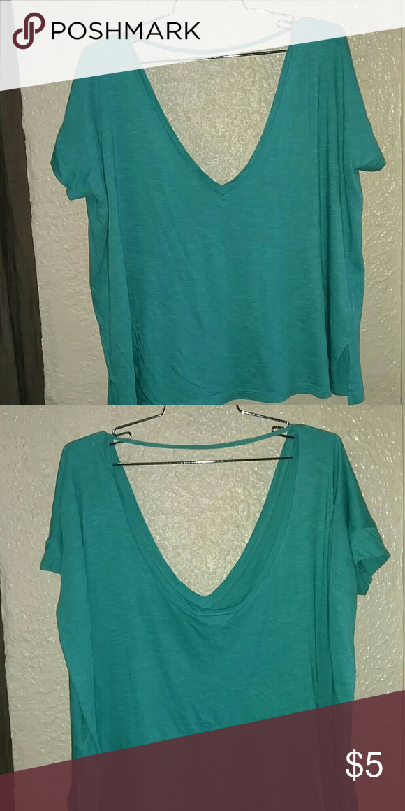 Teal oversized crop shirt Forever 21 oversized crop shirt. String across back. V neck in the front. Lightweight soft material. Very comfortable. Don't forget to bundle!! Forever 21 Tops Crop Tops