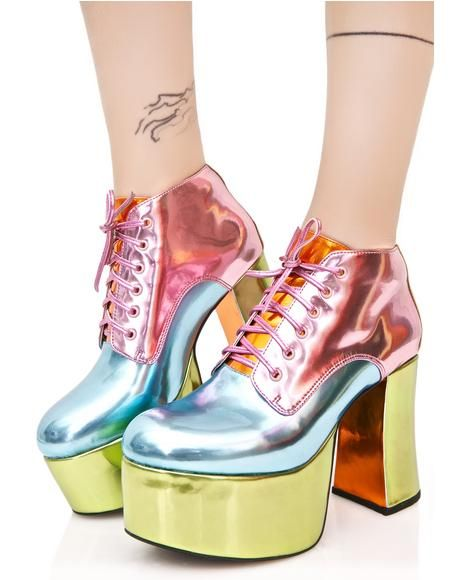 Sugarbaby Pastel Playhaus Platforms wanna get real quirky witcha, bb! These amazing platform oxfords features a totally cute metallic construction in colorblocked pink, blue, and green pastel huez, block heel 'N platform, and thin hot pink lace-up closures.