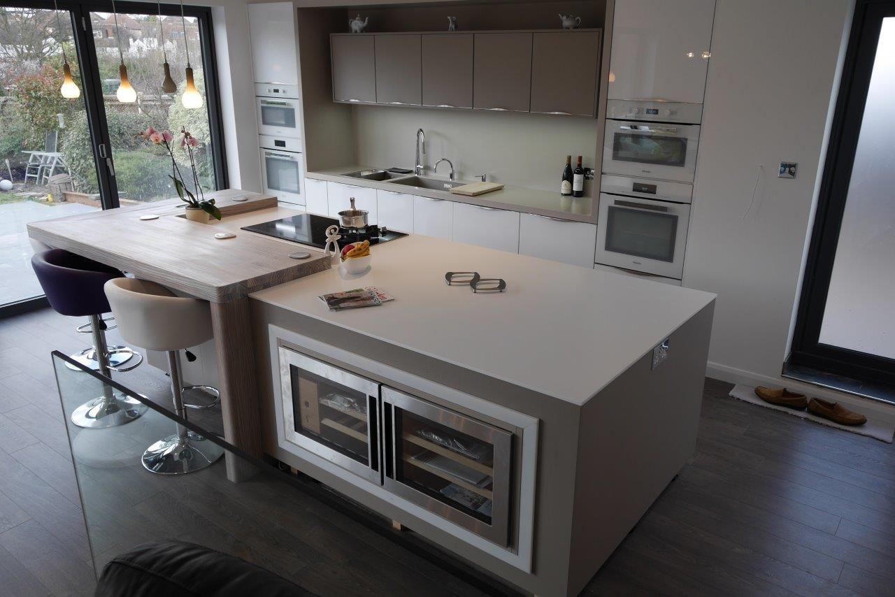 Mix of corian and spekva wood designed by moore by design for Kitchen countertop planner