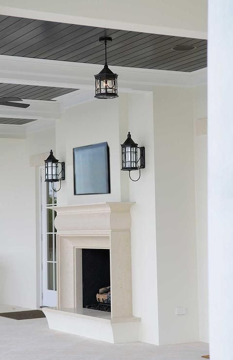 Chic Covered Patio Features A Black Beadboard Ceiling Over A Limestone Composite Fireplace And Hearth Under A Flats Beadboard Ceiling Beadboard Patio Fireplace