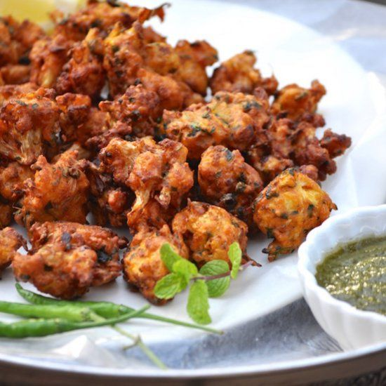 Fiery, Crunchy and Fried to perfection this unique amritsari masala coated cauliflower fritters(pakodas) are scrumptious and delicious!