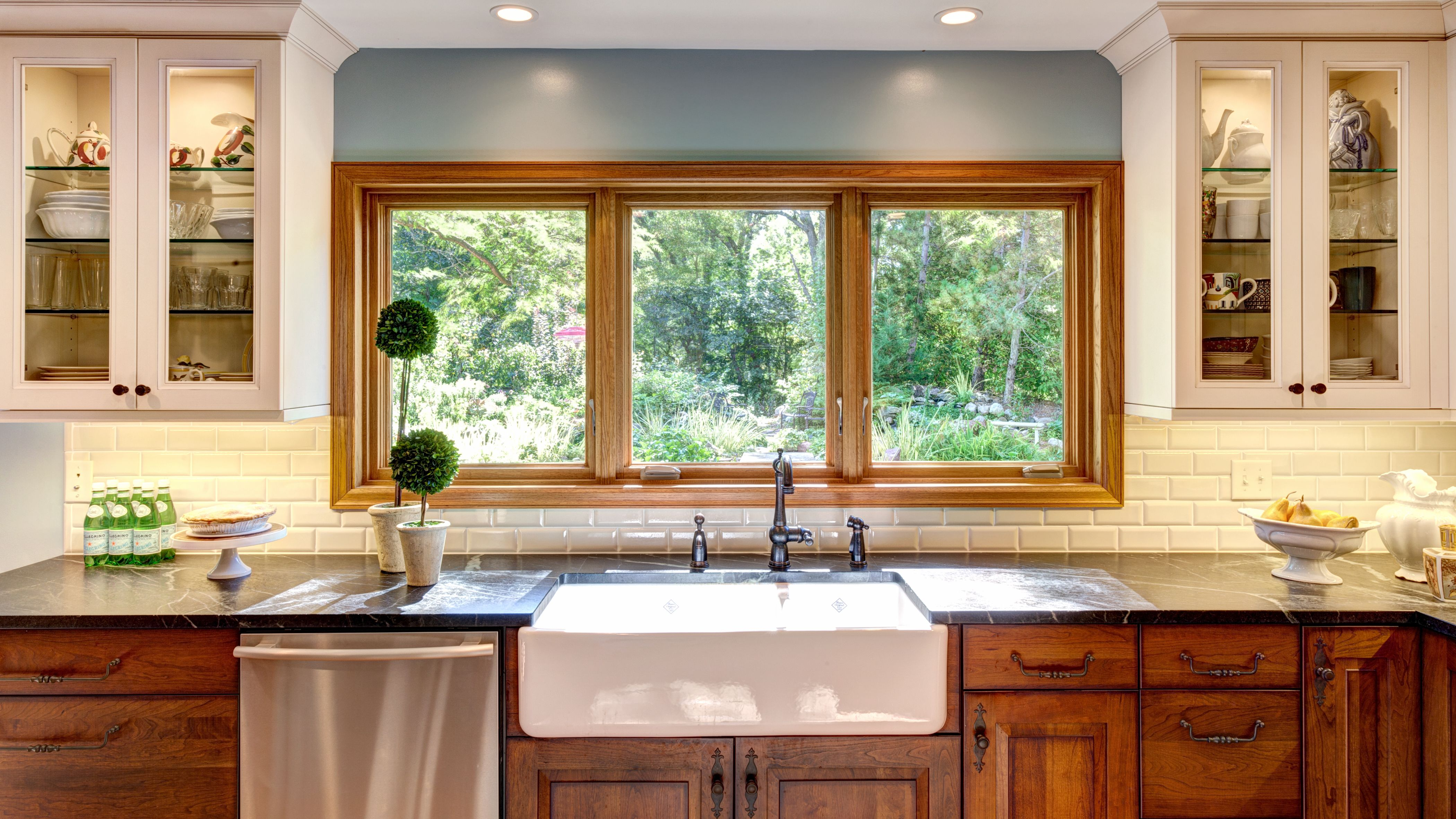 Beautiful kitchen remodel by Codie Donahue Interior Design.  Soapstone countertops and cherry cabinets
