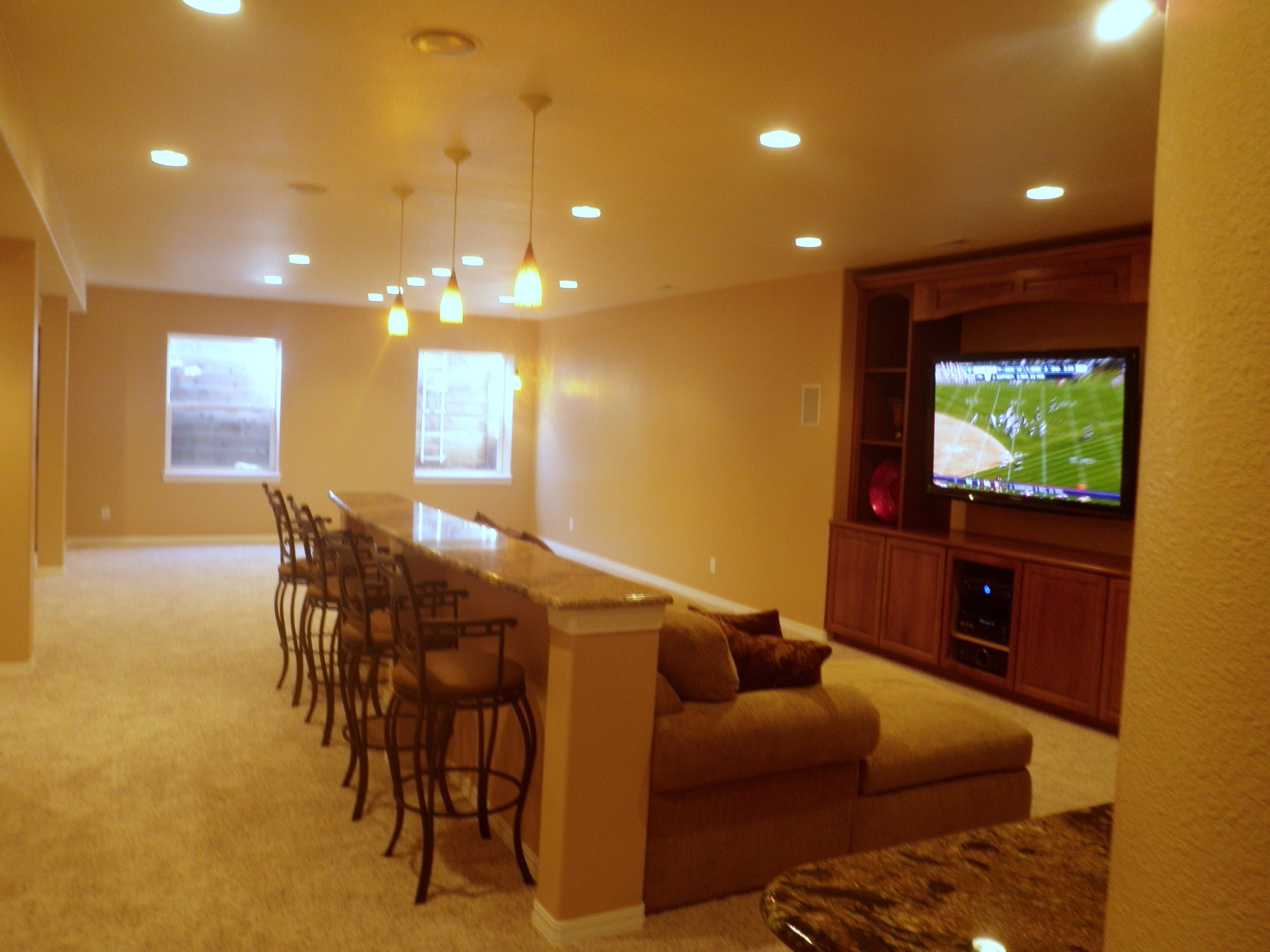 Exceptionnel Man Cave Basement Remodel With Built In Seating Bar Behind The Sectional