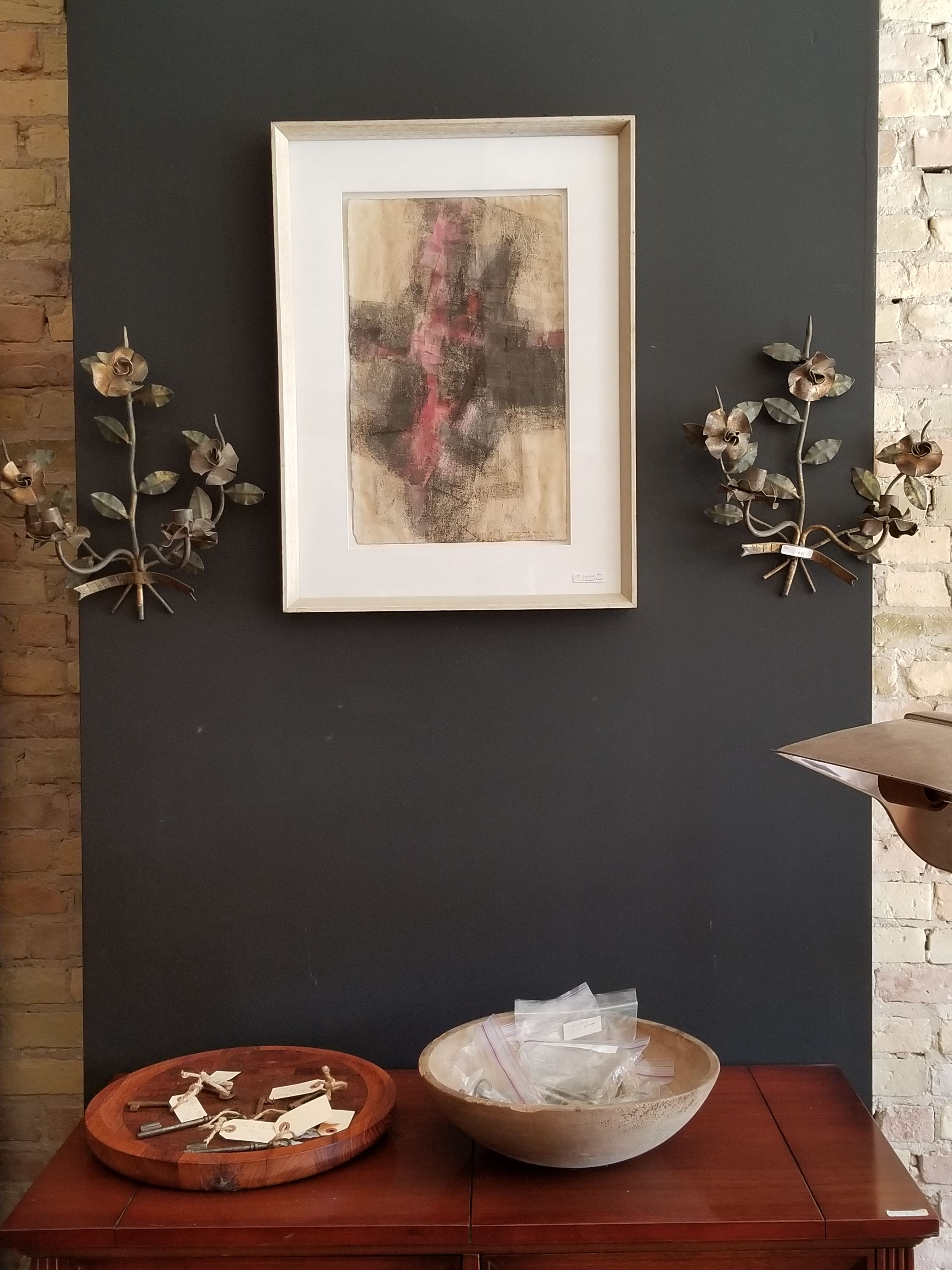 black wall with feature art and wall mounted vintage decorative