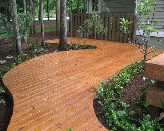 We Used Pressure Treated Ground Contact Wood For The Framing Then We Used Behr Brand Stain For The Treated Deck Deck Around Trees Decks Backyard Curved Deck