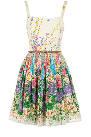 This full skirted sun dress has an all over floral print skirt leading to a floral top. With think straps and a belt attached, this piece has an elasticated back and a zip up the side.