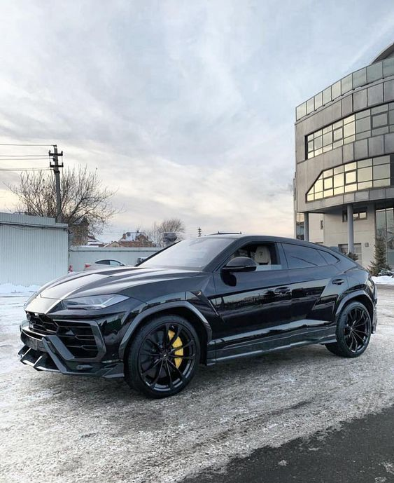 Badass Black Lamborghini Urus with yellow brakes High,end