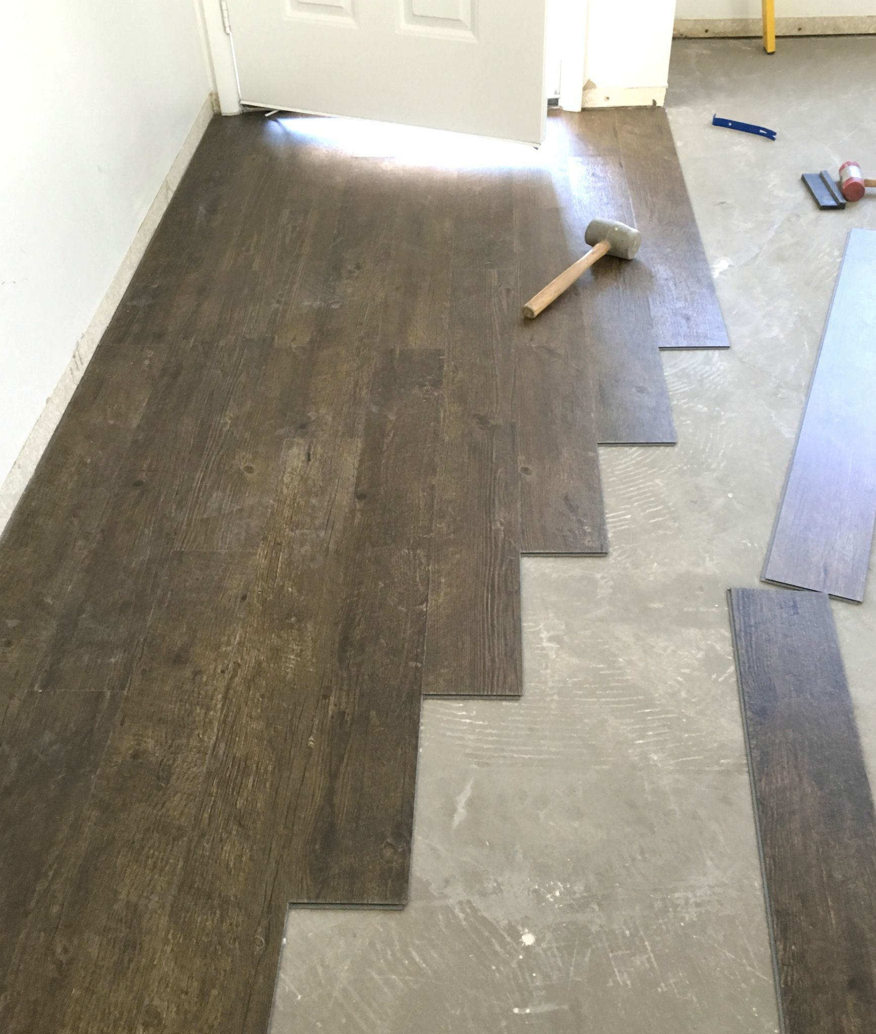 Vinyl plank flooring prep and installation build it with for Pvc wood flooring