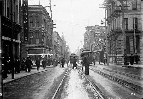 Cleaning streetcar tracks on Sparks St. 1911, Ottawa, Ontario.