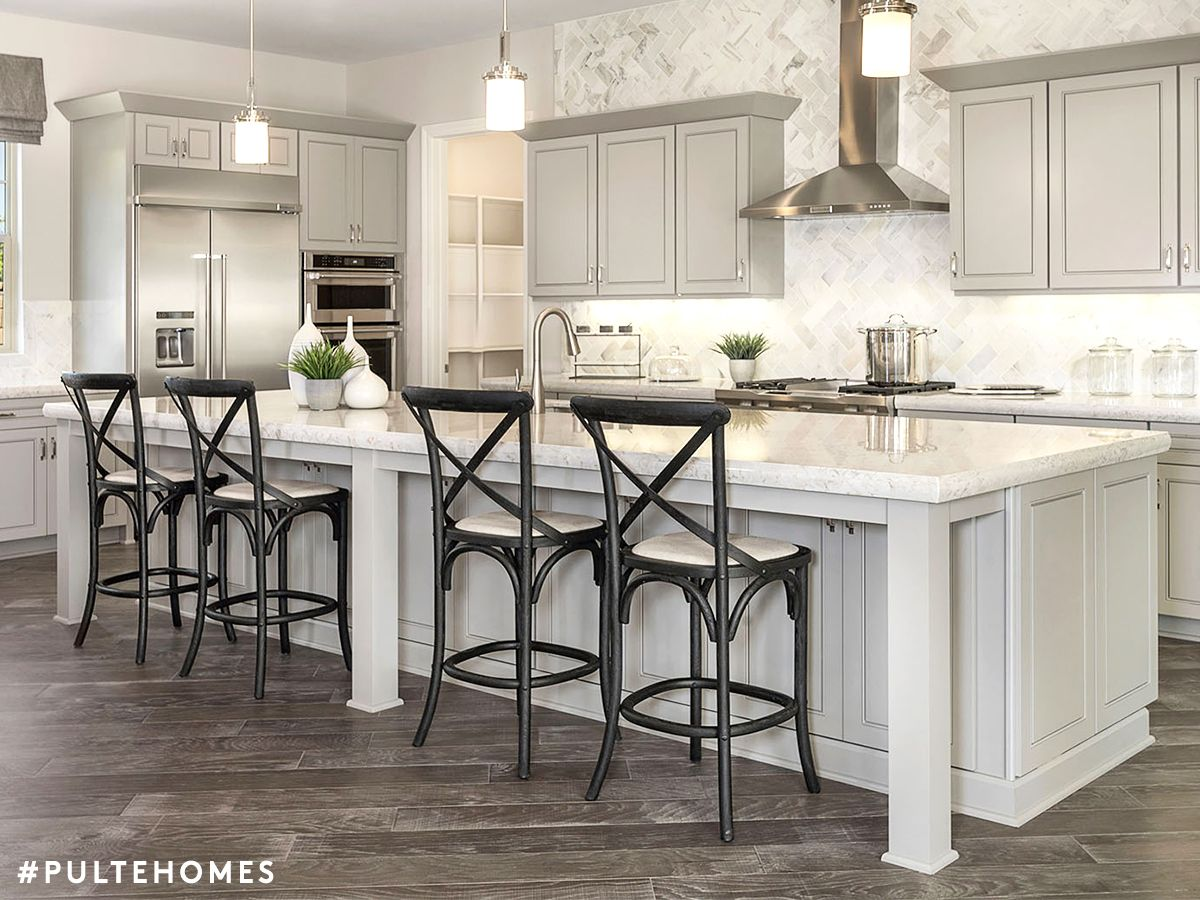 A Kitchen Designed For You To Multitask A Large Island Adds Form And Function By Creating A Space For Your Family Log Home Kitchens Pulte Homes Kitchen Design