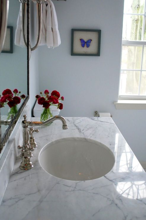 White Carrara Marble Countertops Polished Nickel Fixtures Blue Walls Paint Color And White Marble Bathrooms Marble Bathroom Carrara Marble Bathroom