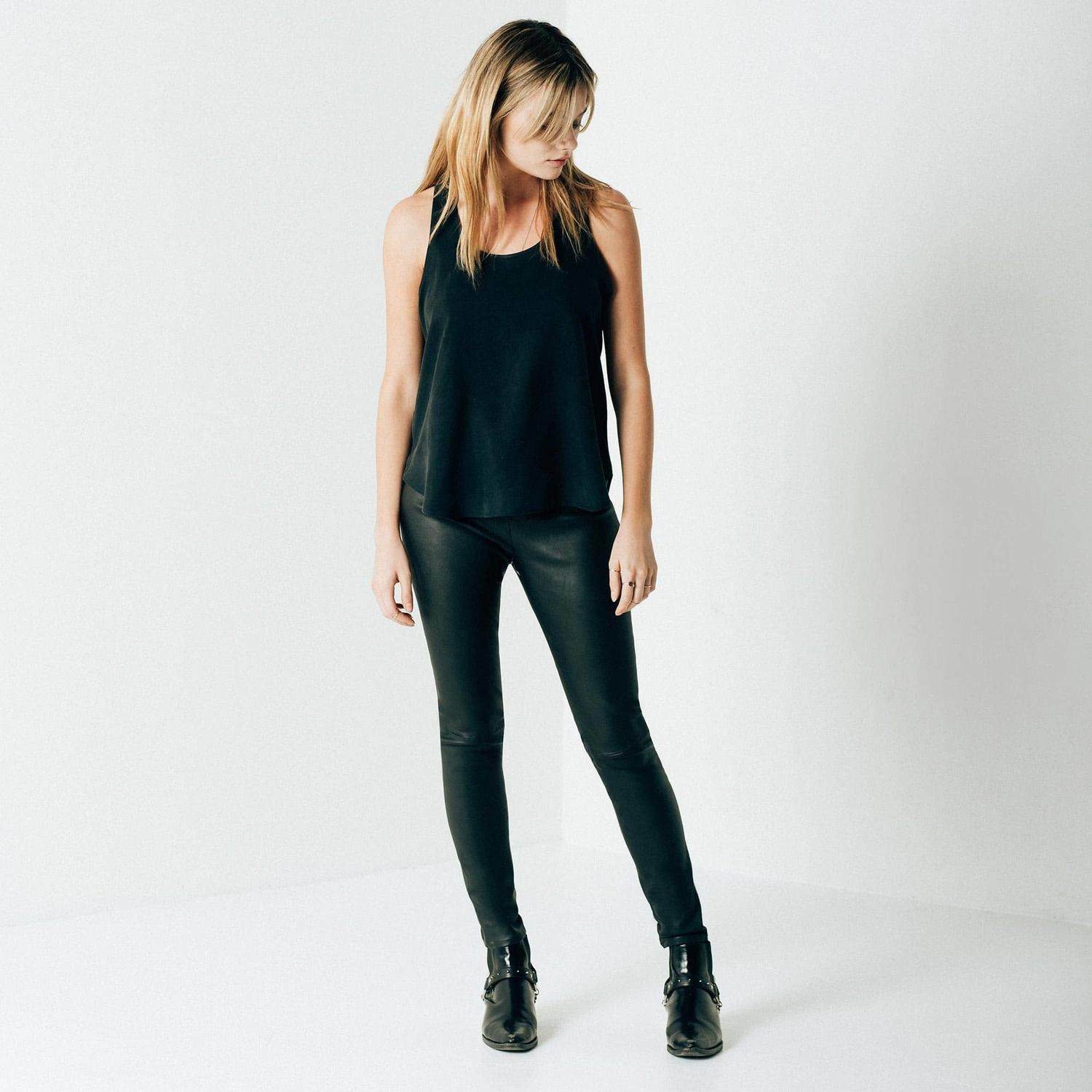 <p>Your newest excuse to defy seasons arrives with our Women's Leather Legging. Designed with metropolitan living in mind, our jet-black supple lambskin leather is specially developed with stretch to achieve a comfortable and sophisticated look. With a concealed side zip closure at the waist, our newest legging is a carefully controlled study in well-crafted contour. Our black stretch leather adds flexibility to a mid-rise, ankle length fit, easily taking you from day tonight.&l...