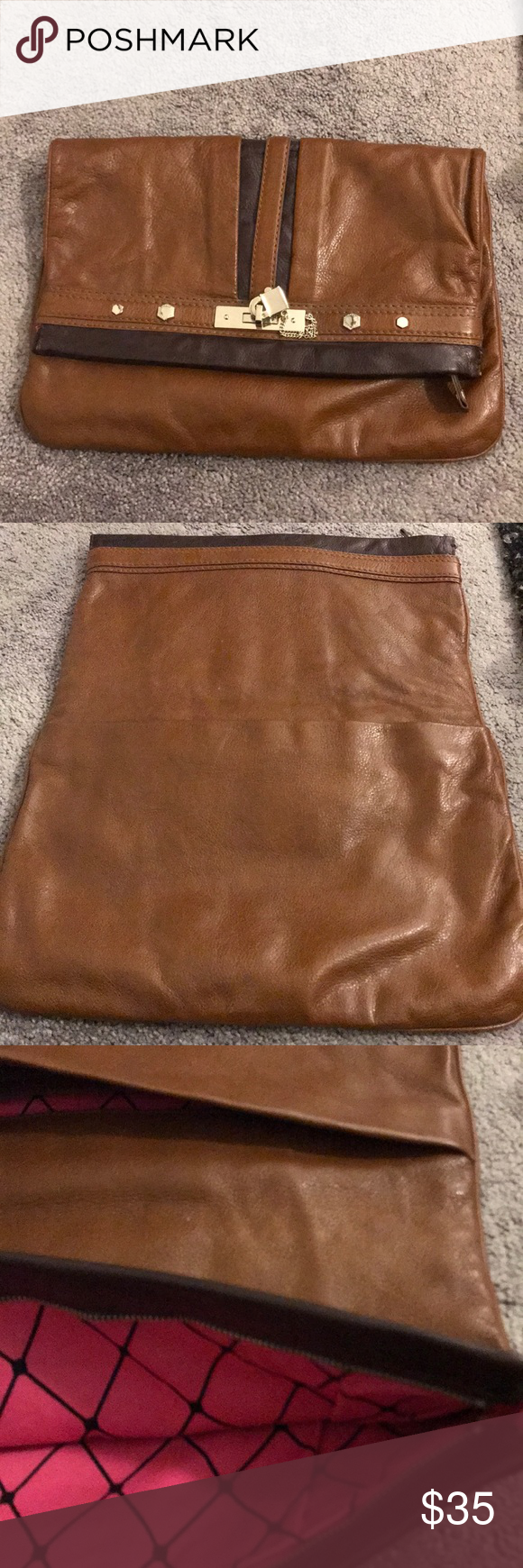 Marc Jacobs clutch Leather brown hand held clutch has two inside pockets top has zipper n is large mint condition pink fabric inside Marc Jacobs Bags Clutches & Wristlets