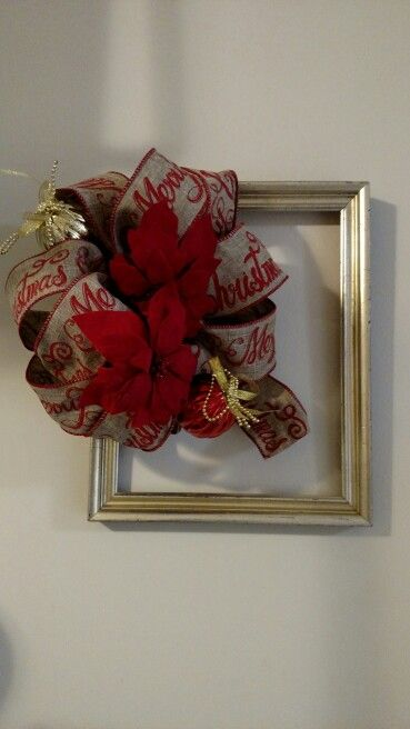 Red and gold picture frame wreath with Merry Christmas bow.