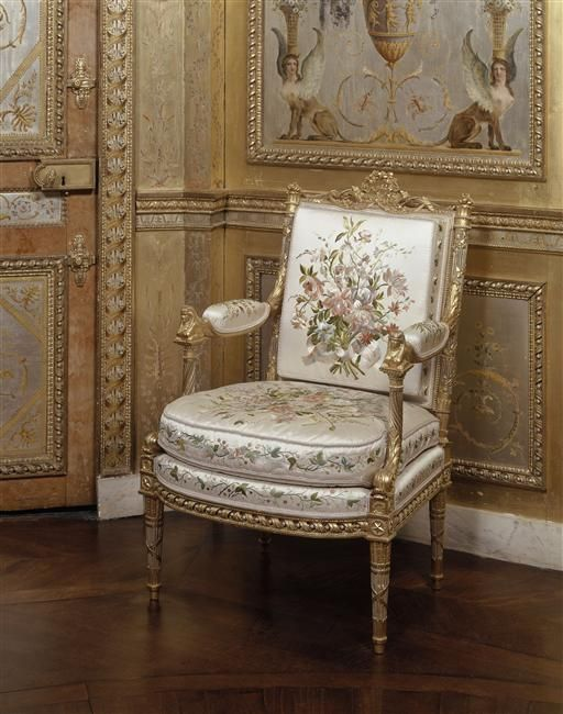 Marie Antoinette Arm chair by George Jacob in her boudoir in Fontainebleau. The arm of the chairs have carved Sphinx at the top also note the painted winged Sphinx above the chair painted by the Rousseau brothers 1786